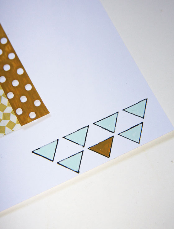 Pochoir triangle utilise en scrapbooking